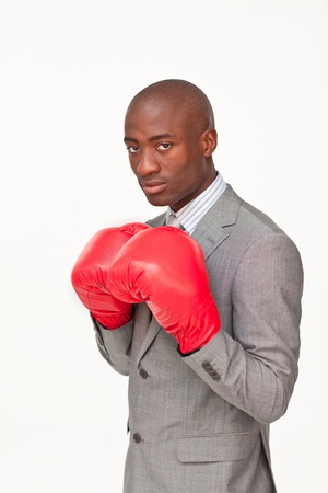 Afro-American businessman with boxing gloves photo