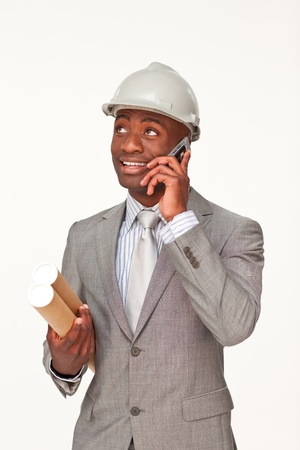 Smiling Afro-American architect speaking on mobile phone Stock Photo - 10105982