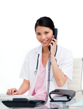 asian doctor: Pretty nurse using her phone