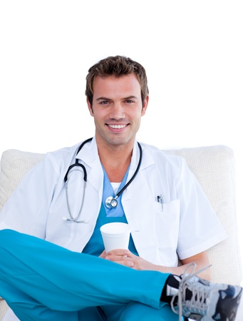 Attractive surgeon sitting on a sofa photo
