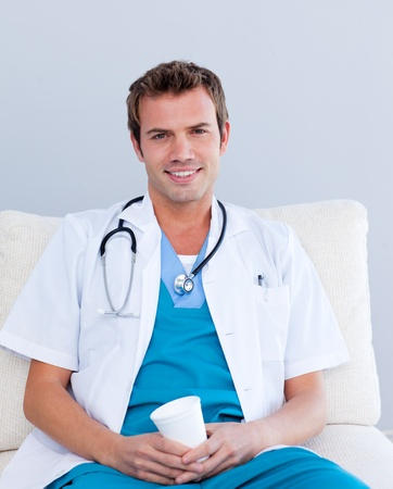 Smiling male doctor drinking coffee Stock Photo - 10096781