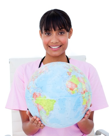 Happy nurse with a globe photo