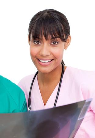 Etnic nurse looking at X-ray photo