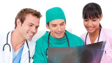 Enthusiastic medical team looking at X-ray photo