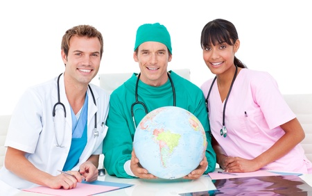 Medical team with a globe Stock Photo - 10096698