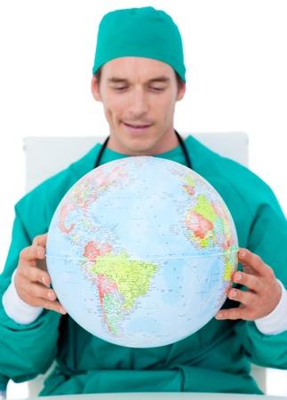 terrestrial: Charming doctor holding terrestrial globe