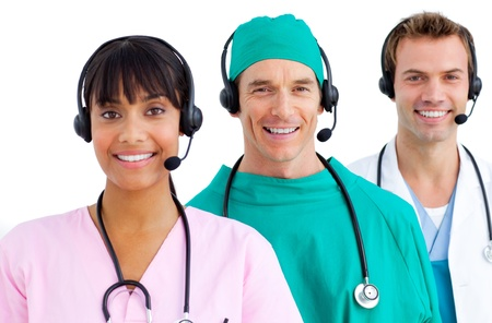 handsfree phone: Confident three doctors smiling against a white background Stock Photo