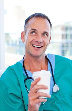 Mature doctor having a break  photo