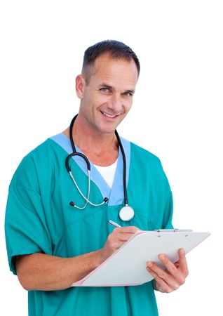 Smiling surgeon writting a report Stock Photo - 10095914