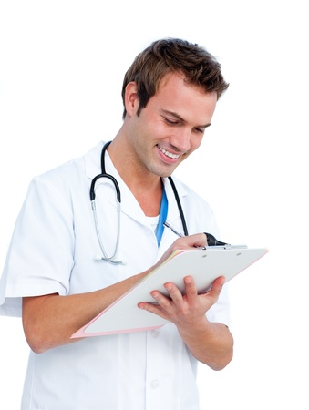 Attractive surgeon writting a report Stock Photo - 10095608