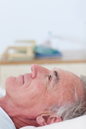 Senior patient lying on a hospital bed  photo