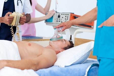 defibrillator: Medical team resuscitating a patient