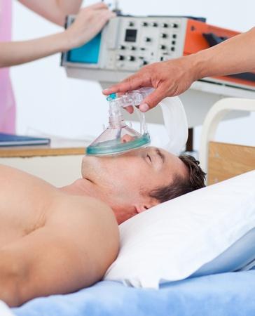 Sick patient receiving receiving oxygen photo