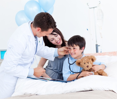 protect family: Charming doctor playing with a little boy and his mother