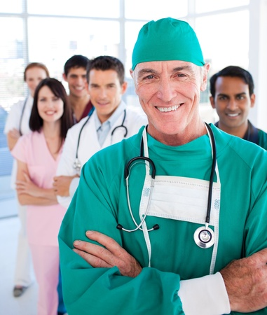medical team: Multi-ethnic medical group smiling at the camera