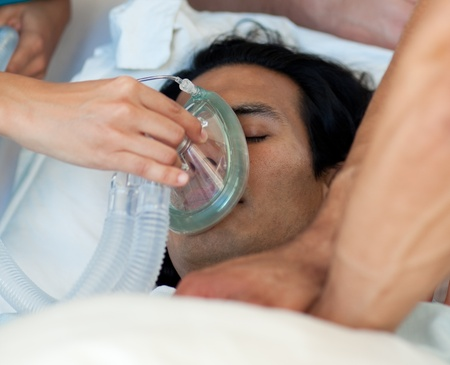 Male patient receiving oxygen mask photo