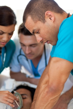 Doctors performing CPR on a patient photo