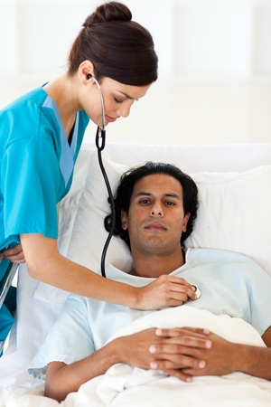 Confident doctor checking the pulse of a patient photo