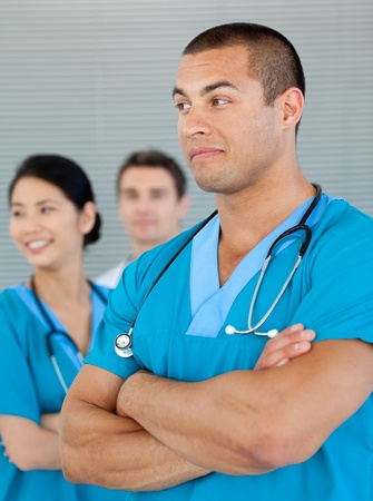 Ethnic doctor with his colleagues in the background photo