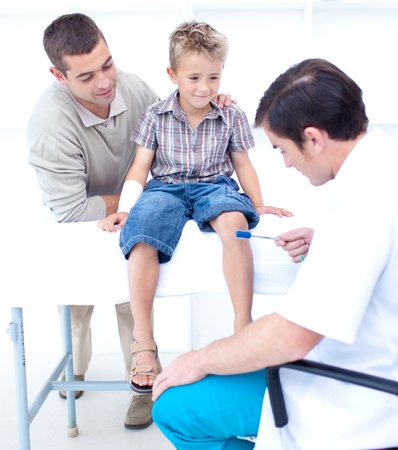 family physician: Doctor checking a patient reflexes Stock Photo