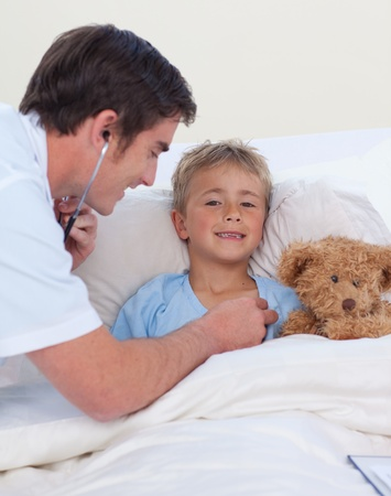 paediatrician: Doctor listening to a child chest with stethoscope