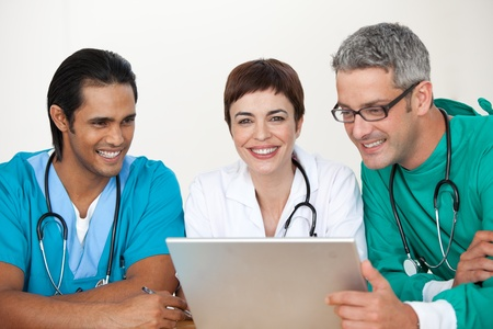 Group of doctors in a meeting  Stock Photo - 10097415