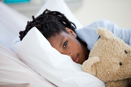 sick in bed: Young Boy in Hospital