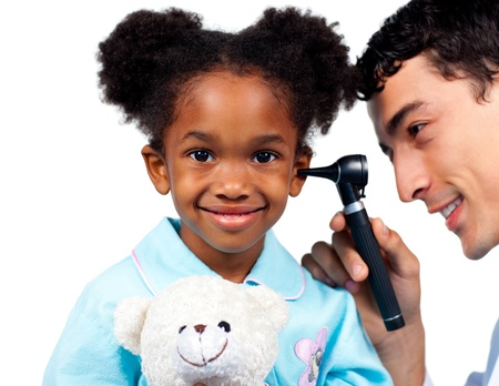 Confident doctor examining his young patient against a white background photo