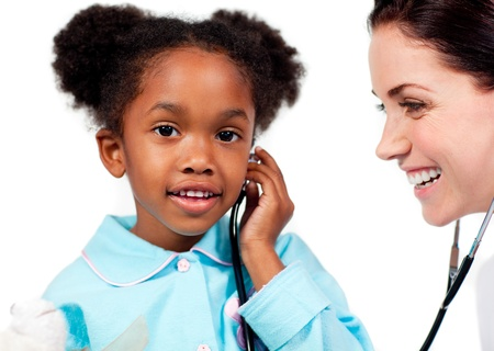 Adorable little girl and her doctor playing with a stethoscope Stock Photo - 10097333