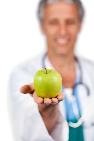 Doctor presenting a green apple  photo