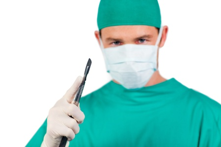 Young male surgeon holding surgical forceps photo