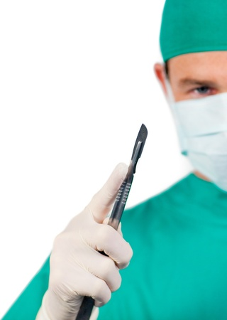 Nice male surgeon holding surgical forceps photo