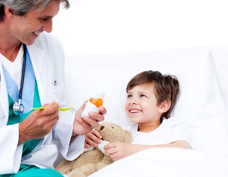 Smiling little boy taking cough medicine Stock Photo - 10106411