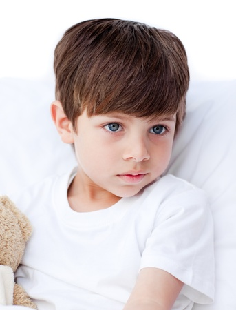 Sick little boy lying in a hospital bed Stock Photo - 10106593