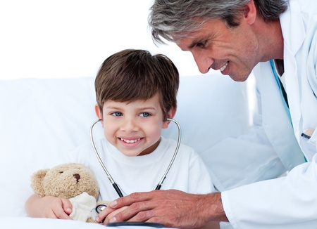 Cute Little boy playing with his doctor photo