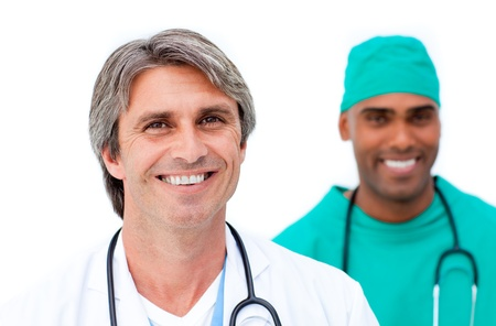 Smiling male doctors standing in a line Stock Photo - 10106667