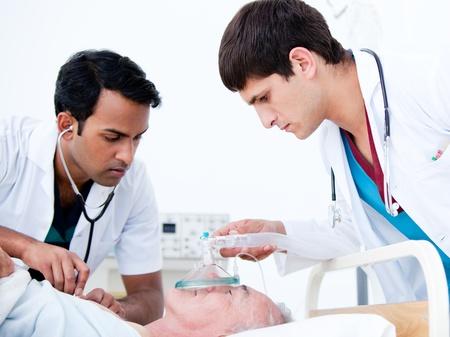 Charismatic doctors resuscitating a patient  photo