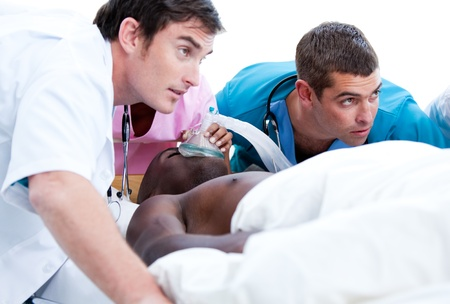 Concentrated medical team resuscitating a patient