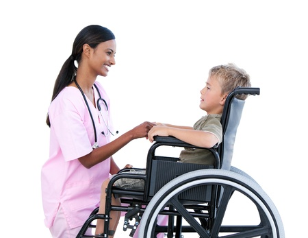 handicapped accessible: Cute little boy in a wheelchair discussing with his doctor Stock Photo