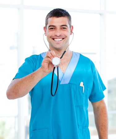Positive male doctor holding a stethoscope Stock Photo - 10106293