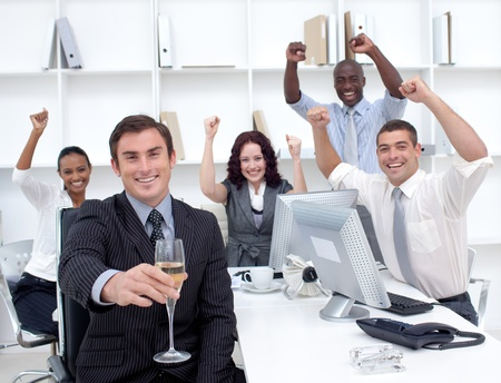 Successful businessteam driking champagne in office photo