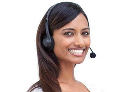Delighted businesswoman with a headset on  photo