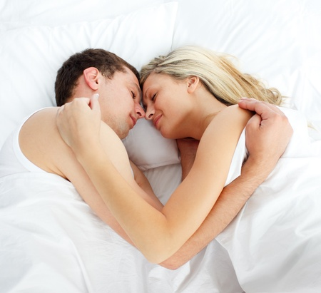 couple cuddling: Boyfriend and girlfriend sleeping in bed