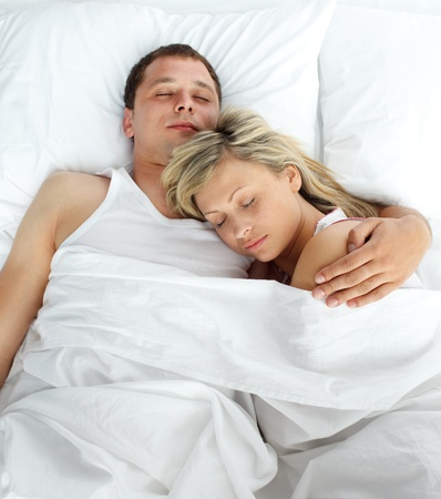 High view of couple sleeping in bed photo