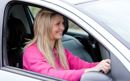 l plate: Attractive female driver at the wheel