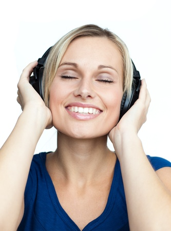 Close-up of woman listening to music with headphones on photo