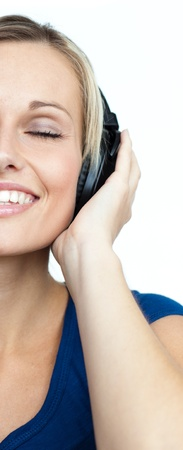 Close-up of woman listening to music and closed eyes photo
