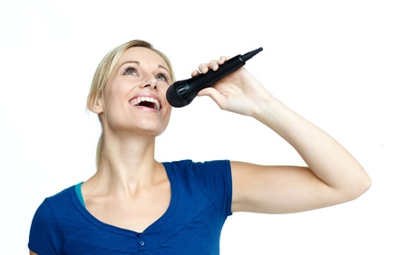 Woman singing on a microphone against white background photo