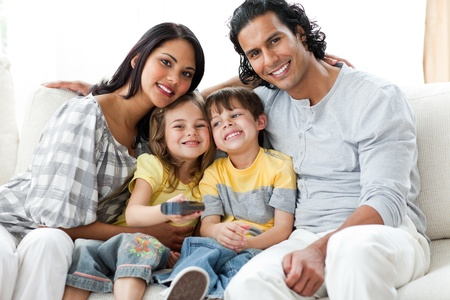 Cheerful family watching TV  together  photo