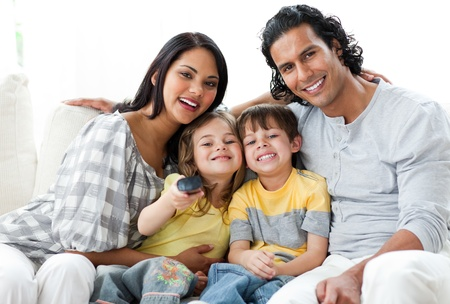 Lively family watching TV  together  photo